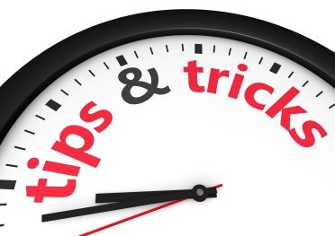 Time for tips and tricks concept with red word and sign printed on a clock face.